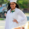 Salem: Salem Academy Charter School graduate Ashley Belis smiles while getting her graduation picture taken outside the Salem Waterfront Hotel prior to the start of graduation on Friday afternoon. David Le/Salem News