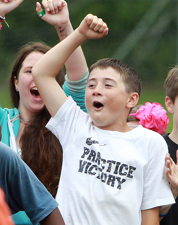 Beverly: North Beverly Elementary School 5th grader Brayden Clarke cheers on his teammates during the 5th graders vs faculty volleyball game on Field Day on Thursday. David Le/Salem News