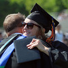 Beverly: Beverly High School graduate Theresa Orr gives Beverly High School Principal Sean Gallagher a hug after receiving her diploma on Sunday afternoon. David Le/Salem News