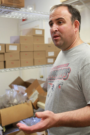 Swampscott: Carlo Bacci, Co-Owner of Bacci Chocolate Design, in Swampscott, talks about the proposed raise to the minimum wage, on Thursday afternoon. David Le/Salem News