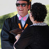 Beverly: Beverly High School graduate Brian Perry smiles and shakes hands with Maria Decker, President of the School Committee as he receives his diploma on Sunday afternoon. David Le/Salem News