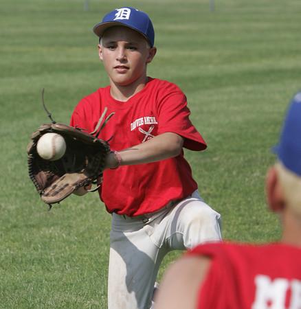 Danvers:<br /> Colby Holland at the Danvers American Little League practice at Memorial Field.<br /> Photo by Ken Yuszkus / Salem News, Monday, June 24, 2013.