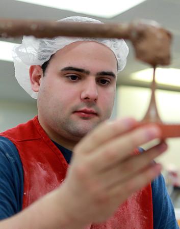 Swampscott: John Allen, an employee at Bacci Chocolate Design, caps off peanut butter cups on Thursday afternoon. David Le/Salem News