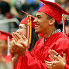 MARY SCHWALM/Staff photo  Salem High School graduate Marvin Baez laughs and applauds during the speech from class president William Parr during the graduation ceremony at the high school in Salem.  6/7/13