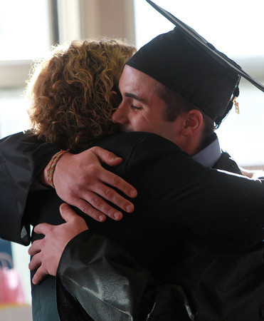 Beverly: Northshore Recovery graduate Andrew McDonald hugs Principal Michelle Lipinski after his Graduation speech on Wednesday evening. David Le/Salem News