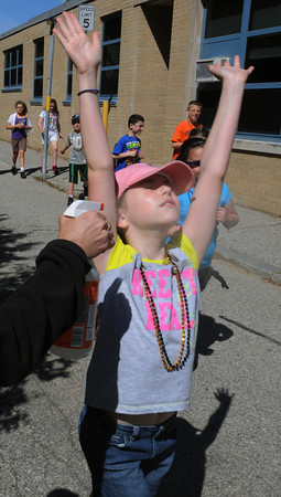 Peabody:<br /> Third grader Madeline Talbot gets misted with water as she passed parent volunteer Lyn Severino during Peabody's Center School walk-a-thon around the school. The students raised money for school.<br /> Photo by Ken Yuszkus, Salem News, Wednesday, June 5, 2013.