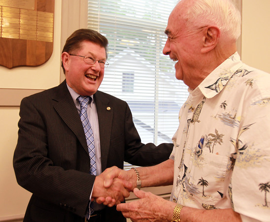 Danvers: Danvers Selectman Dan Bennett, left, shakes hands with Bruce Eaton, right, one of the longest tenured Town Meeting members, on Thursday afternoon. David Le/Salem News
