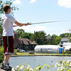 Marblehead: Eighteen-year-old Zach Harkness, of Lynn, casts his line out while fishing at Redd's Pond in Marblehead on Wednesday afternoon. David Le/Salem News