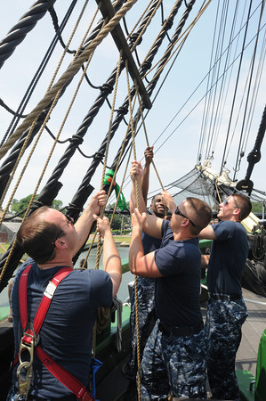 Salem:<br /> Navy sailors from USS Constitution from left, Jacob Jensen, Terray Franklin, Justin Kiel, and Cody Miller train on the Friendship. <br /> Photo by Ken Yuszkus / Salem News, Monday, June 24, 2013.