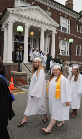 Danvers:<br /> Secretary Kellie Fone of Methuen, left, and treasurer Brianna Mann of Stoneham, lead her fellow class officers and graduates during the processional toward the tent for the Essex Agricultural and Technical High School graduation.<br /> Photo by Ken Yuszkus / Salem News, Thursday, June 6, 2013.