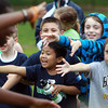 Beverly: From left, Ray Gedagoni, Luke Noonan, and Joseph Marshall hold out their hands for high fives during the fifth graders vs teachers volleyball game at North Beverly Elementary School. David Le/Salem News