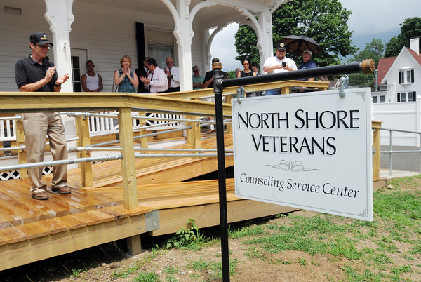 Beverly:<br /> People applaud at the unveiling of the new sign at the conclusion of the dedication ceremony of the newly renovated North Shore Veterans Counseling Service Center building.<br /> Photo by Ken Yuszkus / Salem News, Wednesday, June 26, 2013.