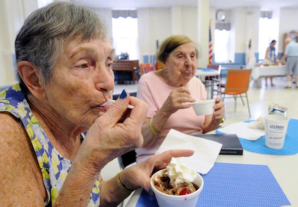 Salem:<br /> Eleanor Twombly, left, and Dot Raczkowski enjoy their ice cream sundaes at the Salem Council on Aging ice cream social.<br /> Photo by Ken Yuszkus / Salem News, Wednesday, June 26, 2013.