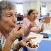 Salem:<br /> Eleanor Twombly, left, and Dot Raczkowski enjoy their ice cream sundaes at the Salem Council on Aging ice cream social.<br /> Photo by Ken Yuszkus / Salem News, Wednesday, June 26, 2013.