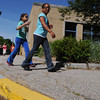 Peabody:<br /> Third graders Laura Espinal, left, and Cyndi DeJesus walk around Peabody's Center School during the walk-a-thon to raise money for school.<br /> Photo by Ken Yuszkus, Salem News, Wednesday, June 5, 2013.