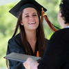 Beverly: Beverly High School graduate Olivia Konaxis smiles as she shakes hands with Maria Decker, President of the School Committee, and receives her diploma at Graduation on Sunday afternoon. David Le/Salem News