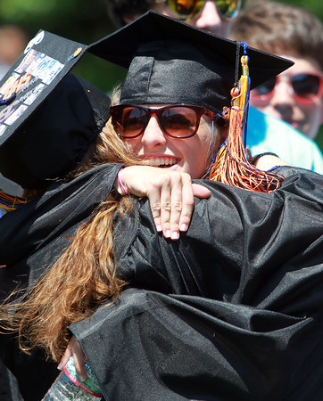 Beverly: Beverly High School graduate Theresa Orr hugs a classmate after they sang the National Anthem with the BHS Chorus for the last time on Sunday afternoon. David Le/Salem News