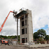 Salem: Workers start building the foundation to a building at 28 Goodhue St. in Salem. David Le/Salem News
