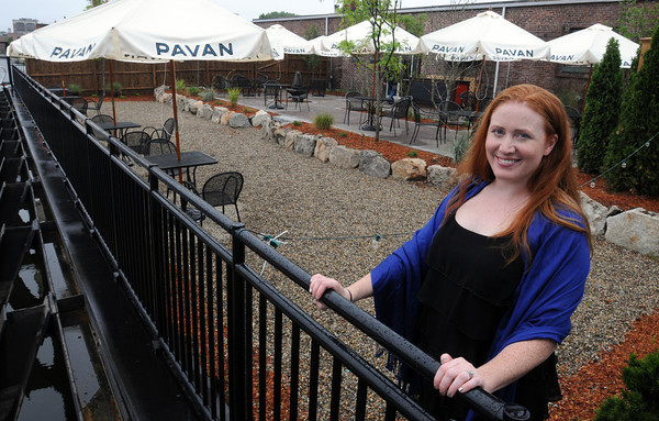 Salem:<br /> Kristin Zarkades, owner of the Grapevine restaurant, stands on the new patio overlooking the South River basin.<br /> Photo by Ken Yuszkus / Salem News, Thursday, June 27, 2013.