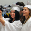 Danvers:<br /> Graduates Madison Overholt of Haverhill, left, takes a photo of Courtney Panero of Groveland and herself before the start of the Essex Agricultural and Technical High School graduation.<br /> Photo by Ken Yuszkus / Salem News, Thursday, June 6, 2013.