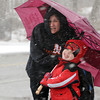 Beverly:<br /> Rachael Mugford and her son James Garofalo, 3, huddle under an umbrella for protection against the wind-driven snow. They were waiting for the bus to pickup James who goes to preschool.<br /> Photo by Ken Yuszkus/The Salem News, Thursday, March 7, 2013.