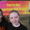 "Beverly:<br /> Ella Colten, left, and Kristen Kalivas stand with one of the Angela Miller signs at the Harry Ball Field. The two Centerville Elementary School fifth-graders raised money to have two banners made to show their support for ""American Idol"" contestant Angela Miller of Beverly.<br /> Photo by Ken Yuszkus/The Salem News, Tuesday, April 2, 2013."