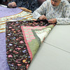 Beverly:<br /> Priscilla Bean of Beverly, left, and Pat Lemares of Salem are part of the quilting group sewing the edge onto an almost finished quilt at the Council on Aging Senior Community Center in Beverly.<br /> Photo by Ken Yuszkus/The Salem News, Wednesday, March 6, 2013.