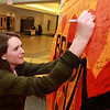 Beverly: Beverly High School senior Haley Mahan signs a poster for Beverly native Angie Miller hanging in the hall at Beverly High School on Wednesday evening during a Community Rally. David Le/Salem News