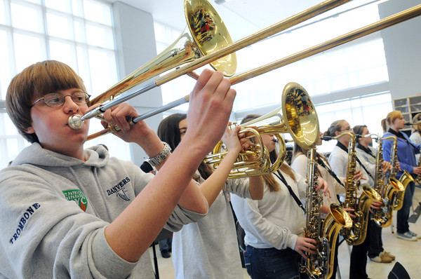 Danvers:<br /> Danvers Falcon Band member Dan Scottgale, left,  plays the trombone during practice. The Danvers Falcon Band will soon be heading off to play in New York City's St. Patrick's Day Parade.<br /> Photo by Ken Yuszkus/The Salem News, Thursday, March 14, 2013.