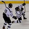 MARY SCHWALM/Staff photo.  St. John's Prep player James Currier, right, celebrates his goal on a assist by teammate Jack McCarthy during their 4-1 loss to Central Catholic in their hockey game in Lowell.  3/3/13