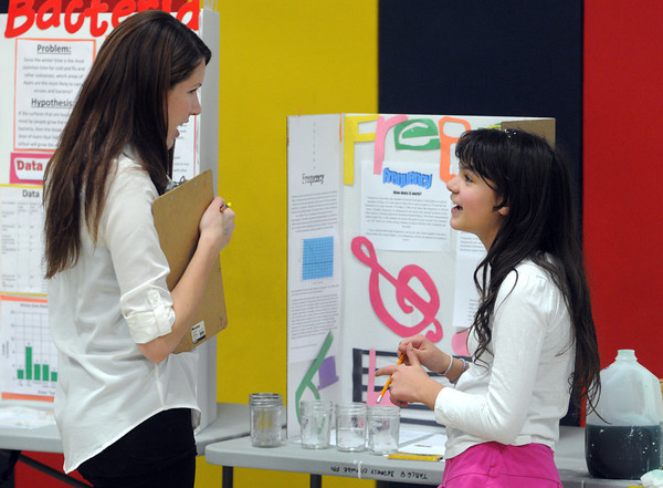 """Beverly:<br /> Judge Danielle Cotter talks with student Elizabeth Desilvestre about her project """"Frequency"""" during the Ayers Ryal Side School science fair.<br /> Photo by Ken Yuszkus/The Salem News, Tuesday, March 12, 2013."""