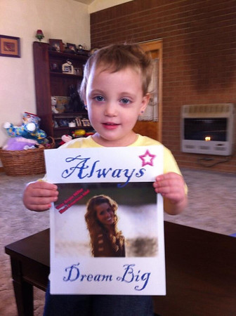 "Danielle Egan-Allgeier of Erie, Pa., shares this photo of her goddaughter, Kaelyn, 2. ""She freaks out every time Angie comes on TV,"" she writes. ""She loves to look at pictures, and when we come across a picture of Angie she screams out, 'ANGIE!!!'"