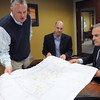 Beverly:<br /> From left, John Vogus, CFO, Ryan Plosker, executive director and founder, both of New England Academy, and builder Stephen Connolly, look over plans for the new school.<br /> Photo by Ken Yuszkus/The Salem News, Wednesday, March 13, 2013.