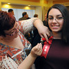 "Danvers:<br /> Angela Romano of Peabody, pins a flower on her daughter, who received the Youth Hero award at the ""Heroes"" breakfast. The American Red Cross of Northeast Massachusetts honored 12 area residents as its 2013 ""Heroes"" annual breakfast.<br /> Photo by Ken Yuszkus/The Salem News, Thursday, March 21, 2013."