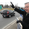 Peabody:<br /> State rep. candidate Dave Gravel waves to passing drivers while campaigning on Lowell Street at the junction of Route 1 in Peabody.<br /> Photo by Ken Yuszkus/The Salem News, Monday, March 18, 2013.