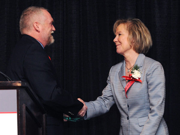 """Danvers:<br /> Karen Stewart receives the Mission into Action Hero award from Brian Murphy at the """"Heroes"""" breakfast. The American Red Cross of Northeast Massachusetts honored 12 area residents as its 2013 """"Heroes"""" annual breakfast.<br /> Photo by Ken Yuszkus/The Salem News, Thursday, March 21, 2013."""