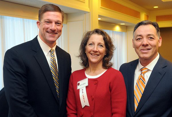 """Danvers:<br /> From left, Jeff Kutz of North Andover, Lauren Baker of Swampscott, and Bill Gaudino of Tyngsborough attend the """"Heroes"""" breakfast. The American Red Cross of Northeast Massachusetts honored 12 area residents as its 2013 """"Heroes"""" annual breakfast.<br /> Photo by Ken Yuszkus/The Salem News, Thursday, March 21, 2013."""