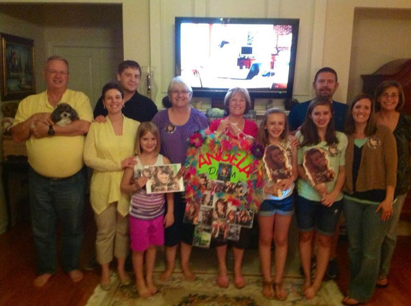 """Tina Keeve, second from right, of Cumming, Ga., shares this photo  from her recent """"American Idol"""" viewing party. The group, made up of friends and cousins of Miller's mother Tana, gathers each week to cheer Miller on. Courtesy photo"""