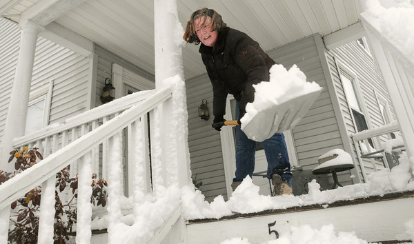Beverly:<br /> Dorothy Mahoney of Beverly shovels the snow off her mother's porch in Beverly after the snowstorm.<br /> Photo by Ken Yuszkus/The Salem News, Tuesday, March 19, 2013.
