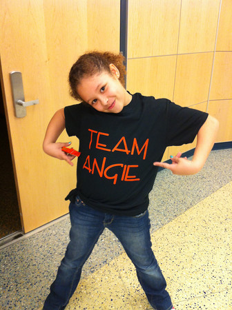 Makayla Jones, 9, shows off her Team Angie shirt at a rally for Angie Miller at Beverly High School. Courtesy photo