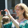 AMY  SWEENEY/Staff photo<br /> Tana Miller takes pictures of the crowd waiting for her daughter American Idol Angie Miller.