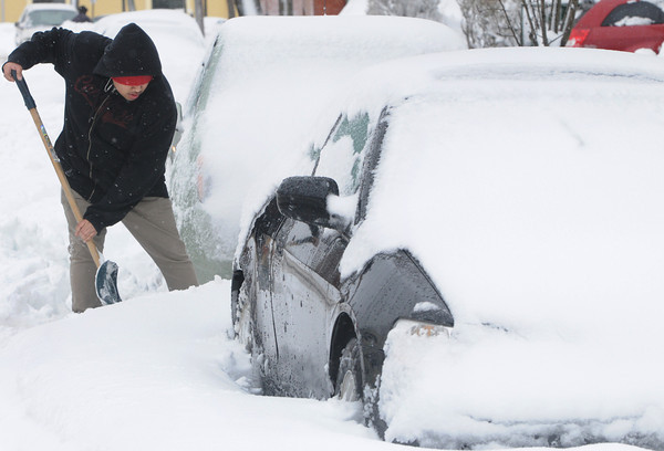 Beverly:<br /> Sam Roberts shovels to free his car from the snow on Essex Street in Beverly.<br /> Photo by Ken Yuszkus/The Salem News, Friday, March 8, 2013.