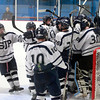MARY SCHWALM/Staff photo.  St. Johns Prep players celebrate their win over Central Catholic during their Super 8 game in Stoneham. 3/10/13