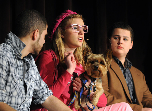 """Peabody:<br /> From left, Nick Tambini as Sandeep Padamadan, Caroline Devereux as Elle Woods, and Nick Tremblay as Emmett practice on stage during a dress rehearsal for """"LEGALLY BLONDE,"""" a musical to be performed at Bishop Fenwick High School. Performances are Friday and Saturday, March 8 and 9, at 7 p.m, and Sunday, March 10, at 2 p.m. Tickets are $10 for adults and $8 for students and senior citizens, and can be purchased at the door. Admission is $1 off if you bring a donation of a canned good. For more information, visit  <a href=""""http://www.fenwick.org"""">http://www.fenwick.org</a>. <br /> Photo by Ken Yuszkus/The Salem News, Thursday, March 7, 2013."""