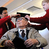 Beverly:<br /> Fred Butler, who at 106 years old received an honorary high school diploma at Beverly High School's libray Monday morning. School committee president Maria Decker, left, and his daughter Kathy Snow place a motarboard upon his head during the ceremony.<br /> Photo by Ken Yuszkus/The Salem News, Monday, March 4, 2013.