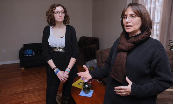 Danvers:<br /> Co-founder Angelina Kalafatis, left, listens to her mother, co-founder/director Emily Korkaris speak about their LITEhouse, Inc. home while standing in the livingroom of the home.<br /> Photo by Ken Yuszkus/The Salem News, Friday, March 22, 2013.