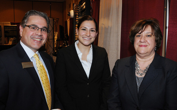 Danvers:<br /> From left, David Lops of Mortgage Financial, Tina Bohondoney and Mary Lou DaSilva, both of North Shore Bank, attend the North Shore Business Expo at the Double Tree by Hilton on Tuesday.<br /> Photo by Ken Yuszkus/The Salem News, Tuesday, March 5, 2013.