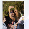 AMY  SWEENEY/Staff photo<br /> American Idol Angie Miller takes photos of her fans  from her home before she starts her American Idol journey of a parade and concert at Beverly High School.