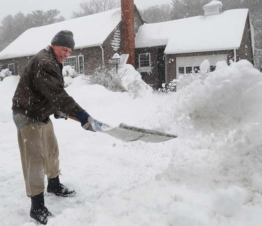 Beverly:<br /> Adil-Gerai Kussow shovels his driveway during the snowstorm on Friday.<br /> Photo by Ken Yuszkus/The Salem News, Friday, March 8, 2013.