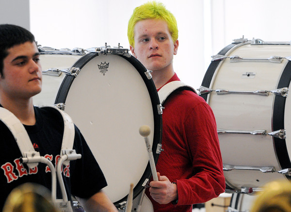 Danvers:<br /> Danvers Falcon Band member Ben Appel, right, and Don Bean, left, practice in the band room. The Danvers Falcon Band will soon be heading off to play in New York City's St. Patrick's Day Parade.<br /> Photo by Ken Yuszkus/The Salem News, Thursday, March 14, 2013.